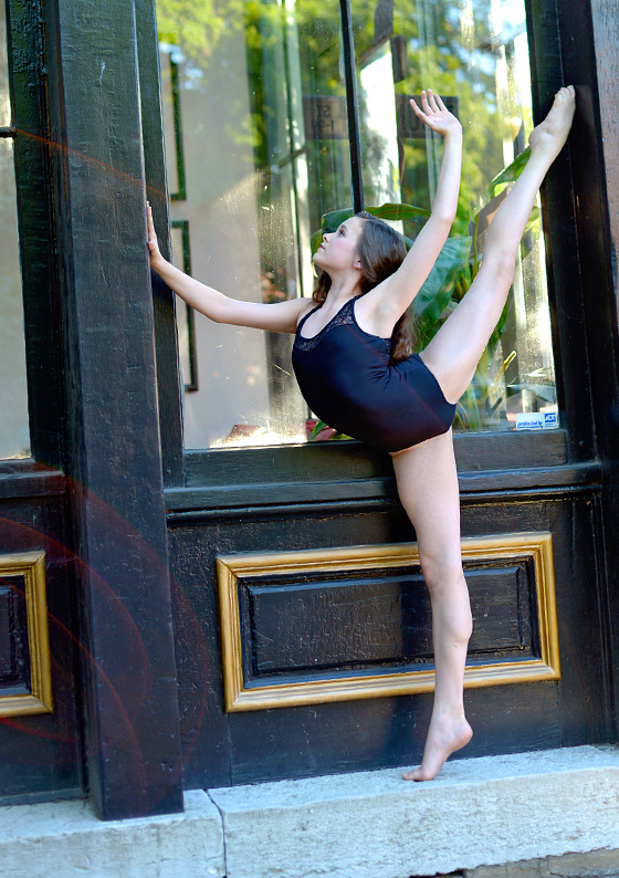 dayton dance conservatory ballet dancer pose in front of window storefront downtown dayton ohio