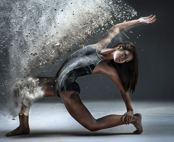 dayton dance conservatory dancer action pose throwing flour