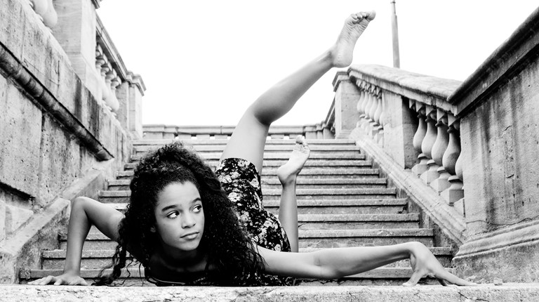 dayton dance conservatory dancer posing on stairs of dayton art institute downtown ohio