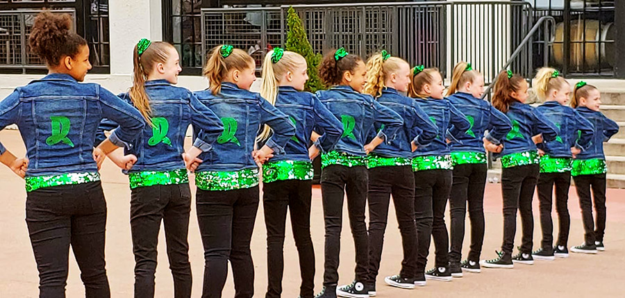dayton dance conservatory mini dugout dancers posing at Fifth Third Field
