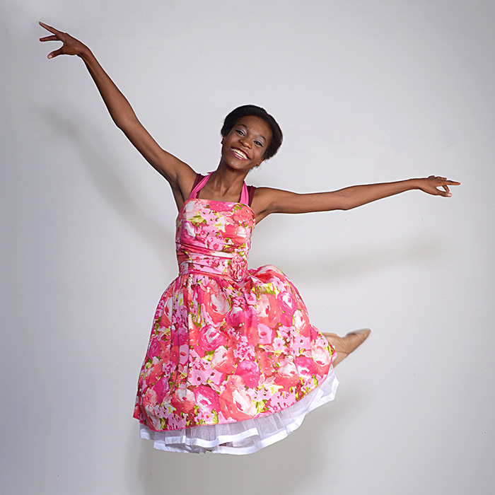 dayton dance conservatory dancer in colorful dress jumping
