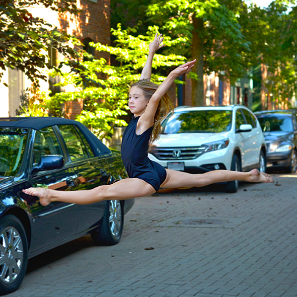 dayton dance conservatory dancer jumping pose in street downtown ohio