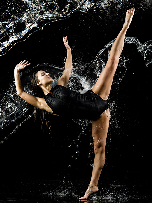dayton dance conservatory dancer action pose high leg kick in water splash